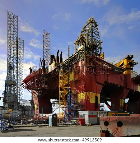 Oil drilling platform for repairs at shipyard