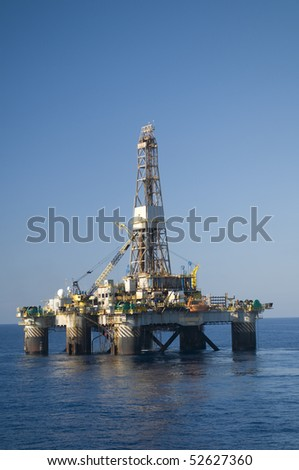Oil drilling rig in offshore area.  Blue sky and calm seas.  Coast of Brazil