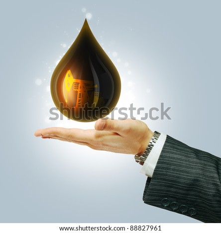 Oil Drop on businessman hand - stock photo