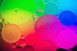 Oil drops in water. Abstract psychedelic pattern image rainbow colored. Abstract background with colorful gradient colors. DOF