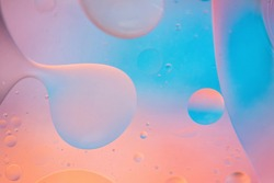 Oil drops in water. Defocused abstract psychedelic pattern image pastel colored. Abstract background with colorful gradient colors. DOF