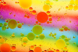 Oil drps in a water .Abstract bubbles on a spotty background. Distortion in water with oil droplets.Rainbow
