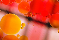 Oil drps in a water .Abstract bubbles on a spotty background. Distortion in water with oil droplets.