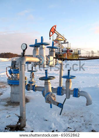 Oil extraction. Oil industry. Construction and mechanism in work.