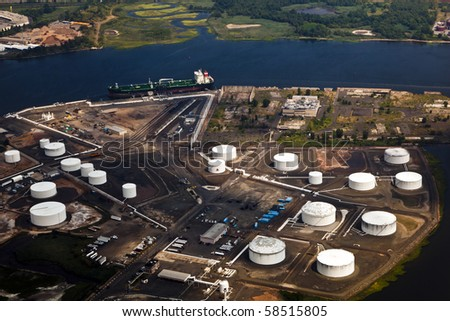 Oil farm with river in Newark, New York - stock photo