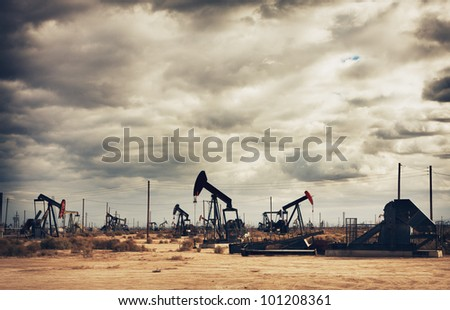 Oil Field in Desert, Oil Production - stock photo