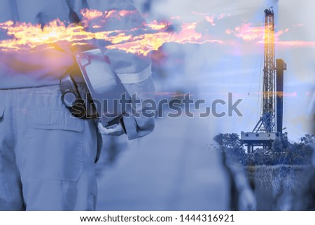 Oil field supervisor, operator or technician is holding safety helmet, preparing to work in drilling operation. Challenge working and safety concept with double exposure photo merge, background.