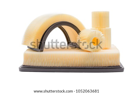 Oil filter and air filter made of fine fibers on a white background. #1052063681