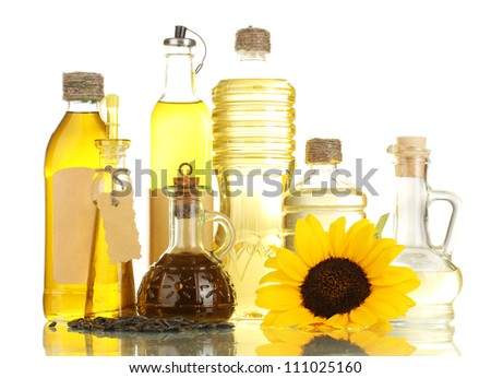 oil in bottles, sunflower and seeds, isolated on white - stock photo