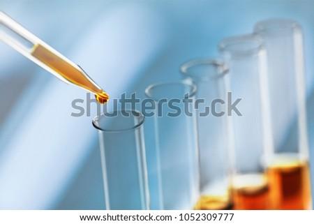 Oil in glass lab tube