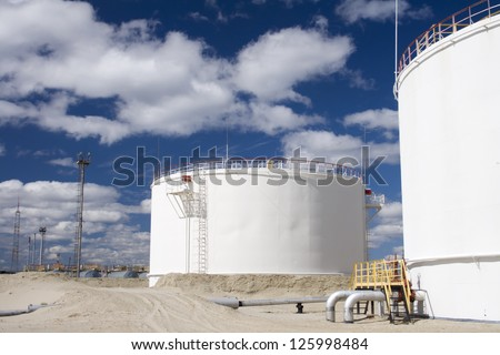 Oil industry and gas industry. Work of refinery petrochemical plant. Oil reservoir and storage tank of mineral oil