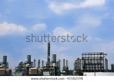 Oil industry equipment installation, metal industrial skyline over blue sky