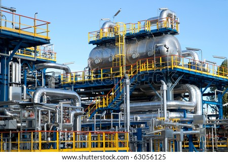 Oil industry equipment installation, metal pipes and tanks