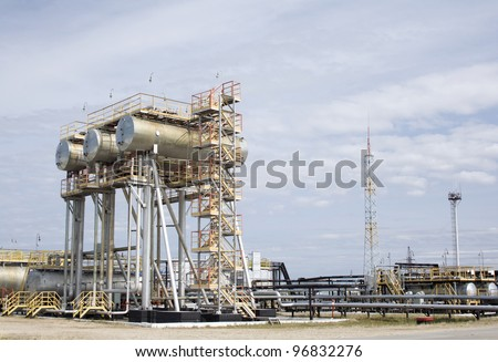 Oil industry scene. Oil and gas refinery plant. Water reservoir