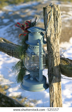 Oil Lamp Hung on Wood Rail Post
