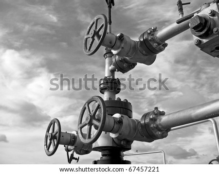 Oil latch on a pipeline. Black and white photo