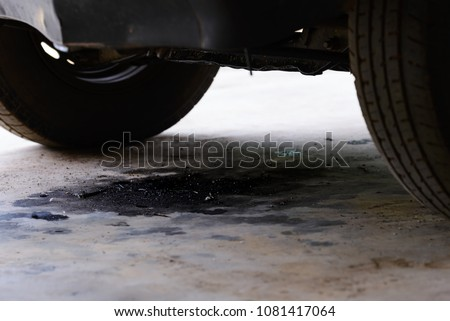 Oil leakage from old car. #1081417064