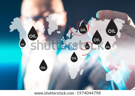 Oil map on virtual screen. Trader or businessman manages oil map. Petroleum industry concept. Oil production sites are marked on  world map. Blurred manager petroleum corporation. Petroleum bussines Сток-фото ©