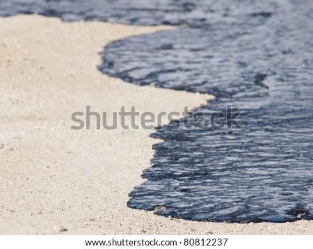 Oil on beach