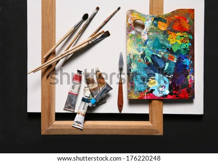 Oil painting set / studio photography of paint utensils on black background