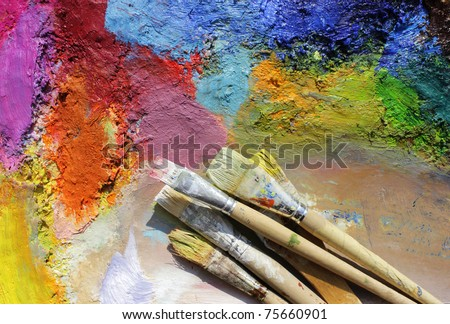 oil paints and paint brushes on a palette - stock photo