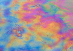 Oil petrol water pollution. Ecological disaster. Slick industry oil fuel spilling water pollution. Water with patches of gasoline and oil. Ecological catastrophe.  Concept of environmental problems
