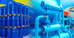Oil pipeline. Concept is the transportation of petrolium to a warehouse through a pipeline. Equipment for packing oil into barrels. Oil barrels are stored in three levels. Petrolium product storage