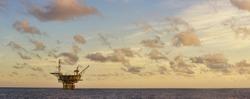 oil platform at sea during sunrise