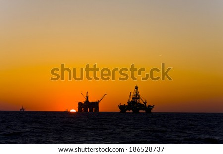 Oil platform on sunset