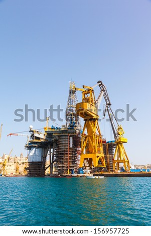 Oil platform repair Shipyards harbor of Malta in clear weather on a background of blue sky