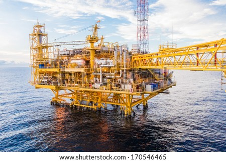 Oil platform yellow color in the sea