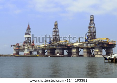 Oil platforms in dry dock undergoing maintenance in Port Aransas, Texas, USA. Names, logos, and identifying marks removed. #1144193381