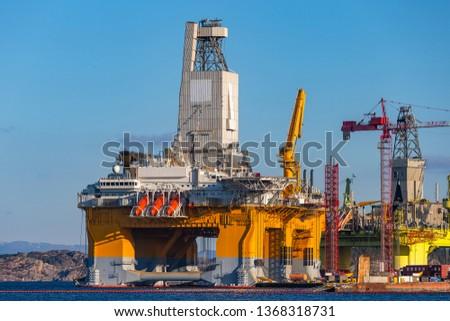 Oil platforms under maintenance near Bergen, Norway. #1368318731
