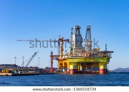 Oil platforms under maintenance near Bergen, Norway. #1368318734