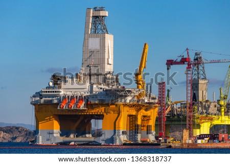 Oil platforms under maintenance near Bergen, Norway. #1368318737