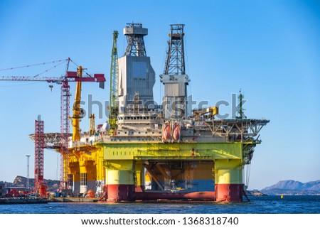 Oil platforms under maintenance near Bergen, Norway. #1368318740