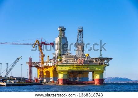 Oil platforms under maintenance near Bergen, Norway. #1368318743