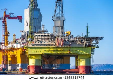 Oil platforms under maintenance near Bergen, Norway. #1368318746
