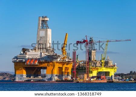 Oil platforms under maintenance near Bergen, Norway. #1368318749