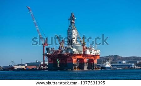 Oil platforms under maintenance near Bergen, Norway. #1377531395