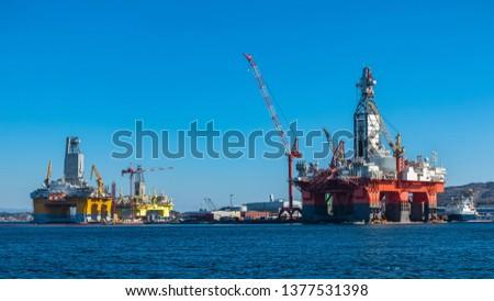 Oil platforms under maintenance near Bergen, Norway. #1377531398