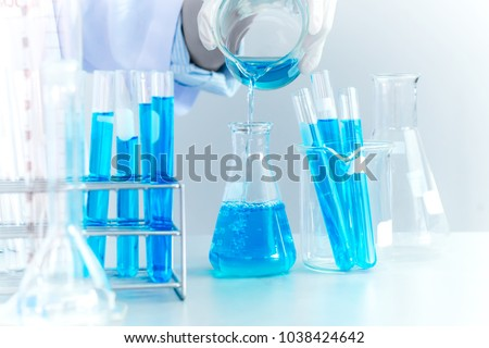 Oil pouring, Formulating the chemical for medicine,Laboratory research, dropping liquid to test tube