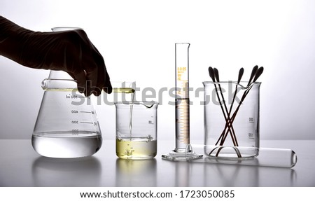 Oil pouring in water, Equipment and science experiments, Formulating the chemical for medicine, Organic extract pharmaceutical, Alternative medicine concept. Stock photo ©