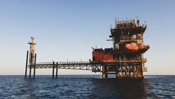 Oil production rig in the sea, landscape. Red Sea, Egypt, Africa, Uninhabited islands.