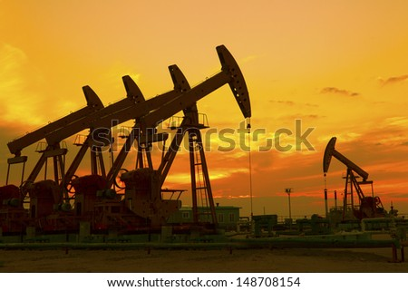 Oil Pump on orange sunset  #148708154