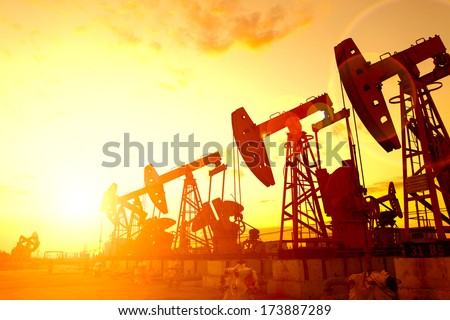 Oil Pump on orange sunset  #173887289