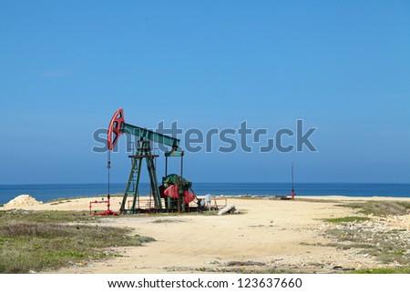 Oil pump on the shores of the Atlantic ocean, the Republic of Cuba