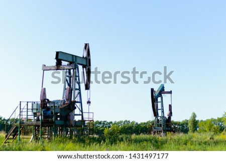 Oil pump or pump installation in a flowering field. Problems of environmental production