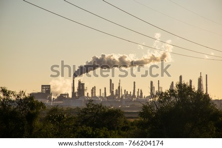 Oil refineries polluting carbon and cancer causing smoke stacks climate change and power plants in Corpus Christi , Texas a massive large refinery #766204174