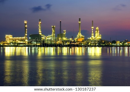Oil refinery at twilight beside Chao Phraya river in Bangkok,Thailand